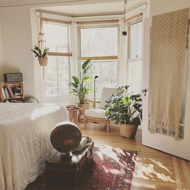 Peaceful bedroom with large sunlit windows