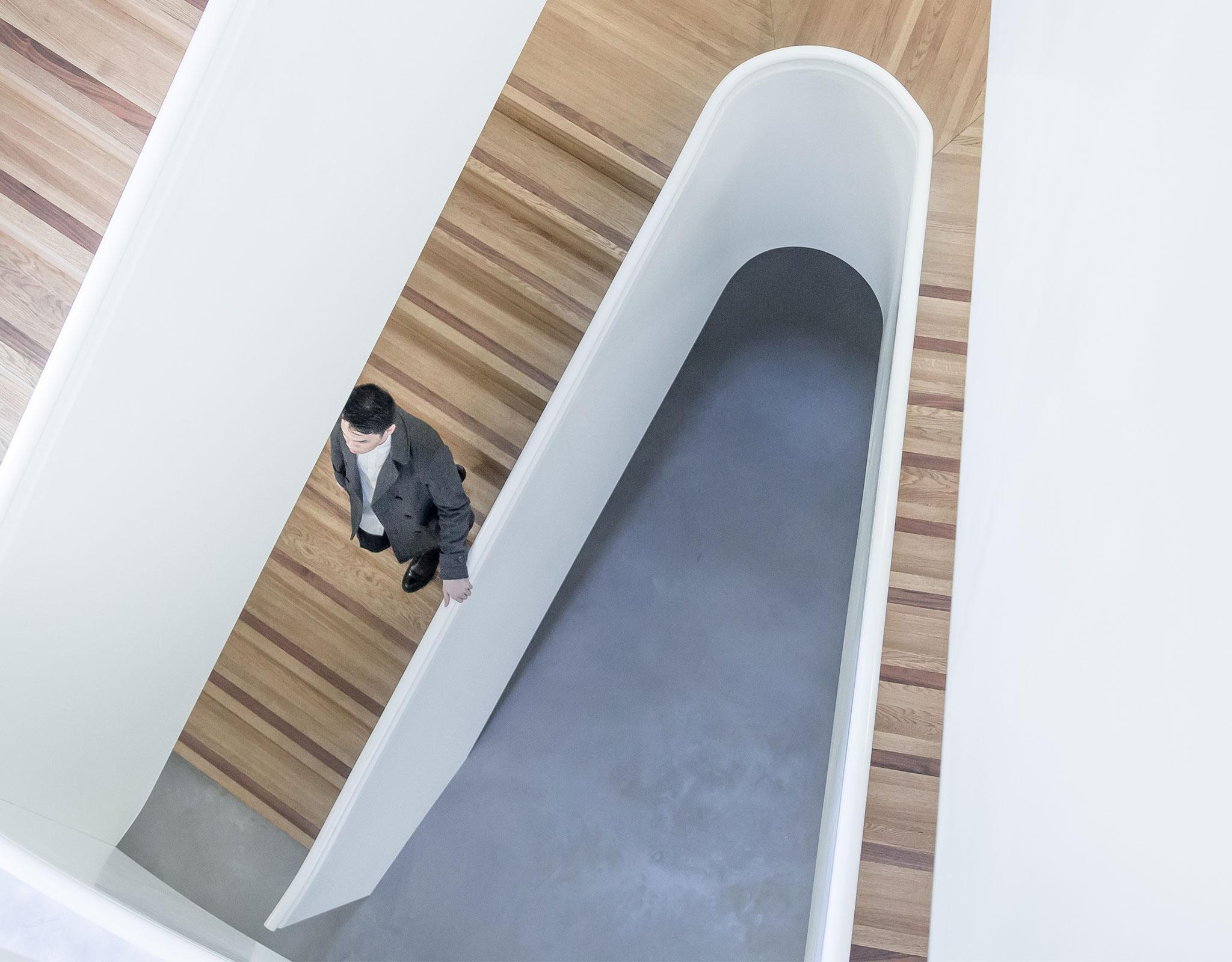 Man walking on stairs in modern building