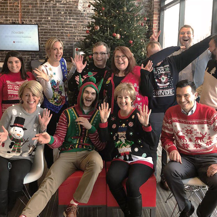 Dundee Bank employees in holiday sweaters
