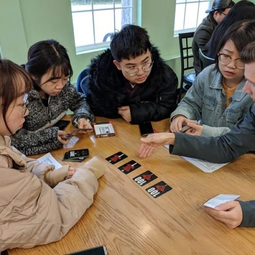 Kids learning a card game