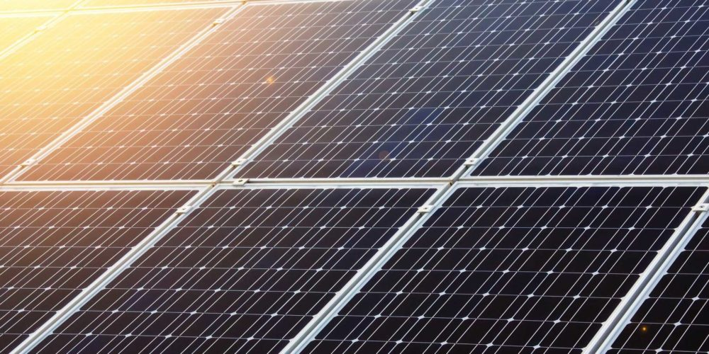 Sun reflecting off solar panels