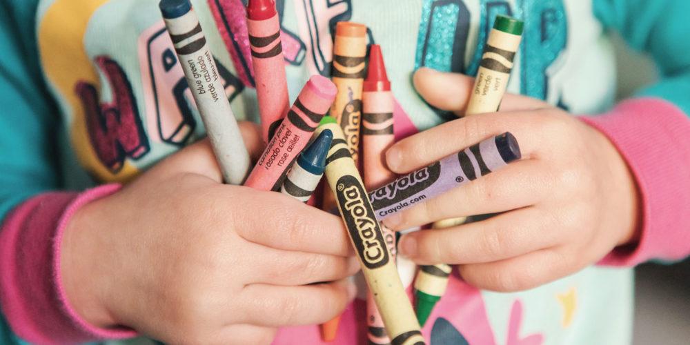 Kid Holding Crayons